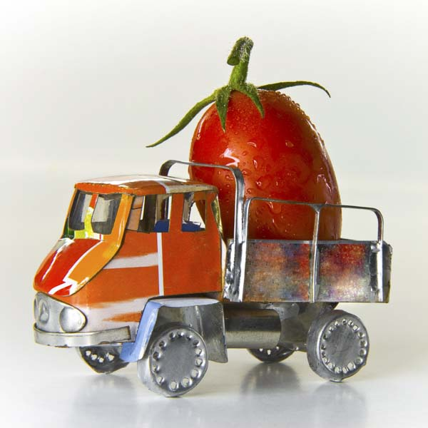 Tomato on the back of a toy truck