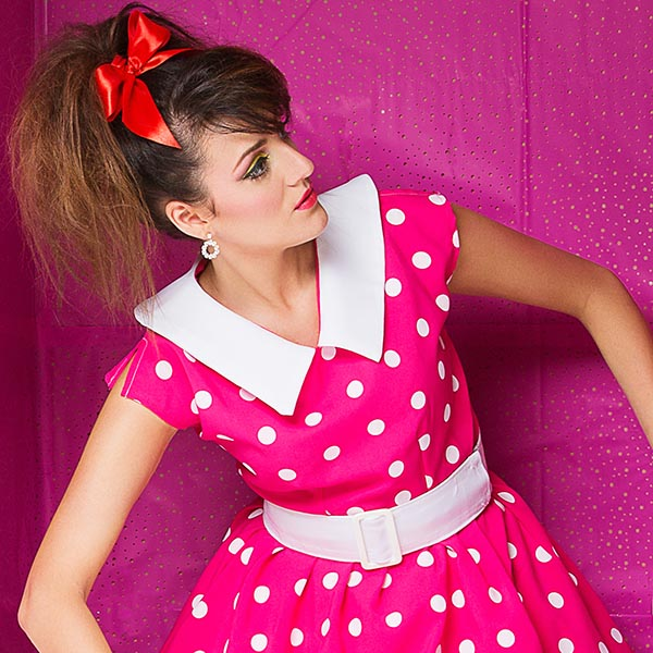 Woman dressed in a pink dotted dress