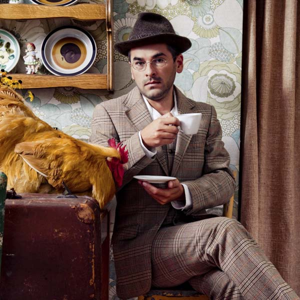Man drinking a coffee with a chicken