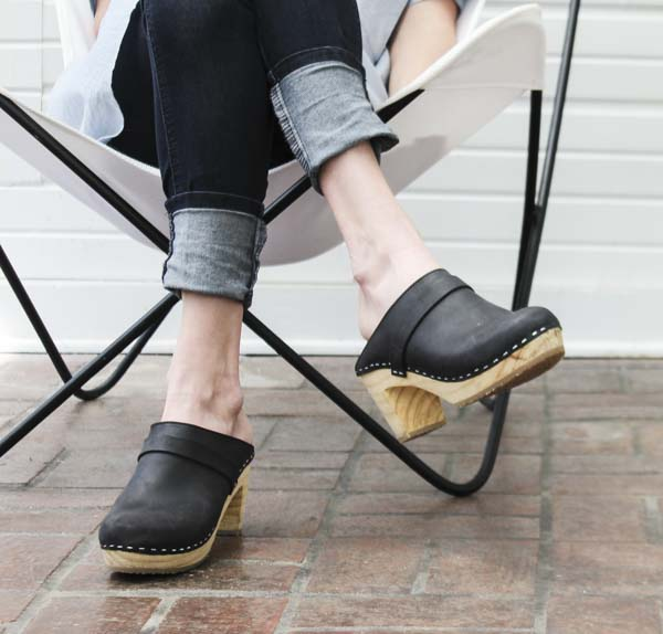 Woman wearing clogs in chair