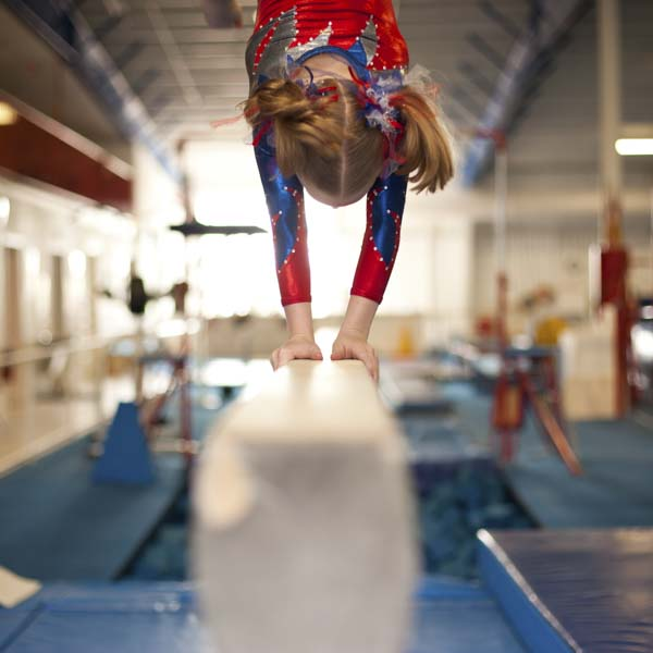 Girl on balance beam