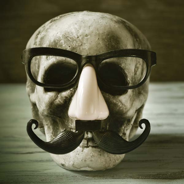 Skeleton head with funny glasses