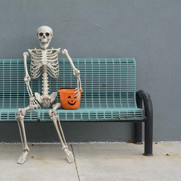 Skeleton with candy at bus stop