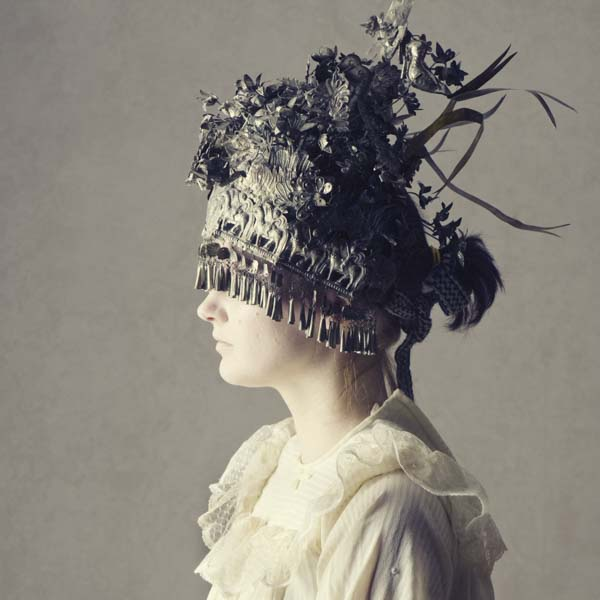 Victorian woman with headpiece covering her eyes