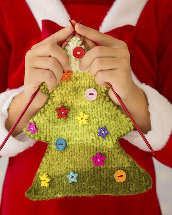 Woman knitting Christmas tree