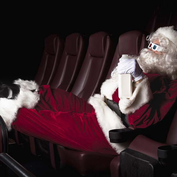 Santa Claus watching movie with 3D glasses
