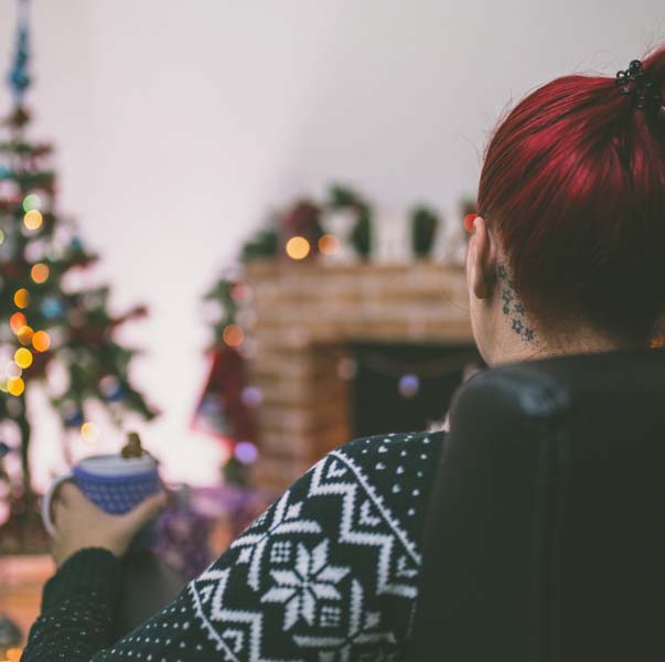 Woman admiring her Christmas decorations