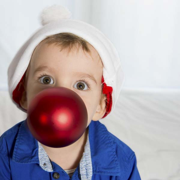 Little boy with ornament that looks like a bubble in his mouth