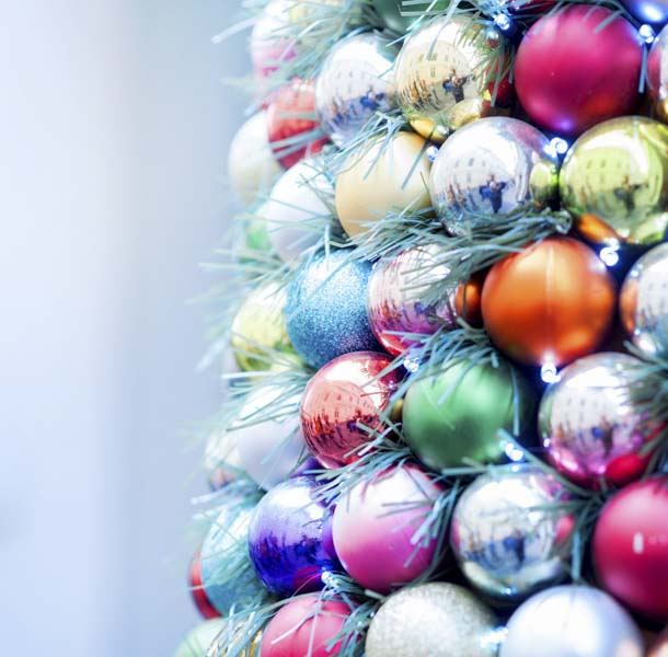 Christmas tree of tinsel and colorful balls