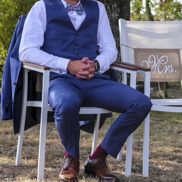 Man sitting in groom's chair at wedding