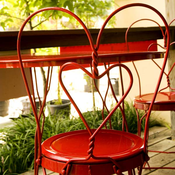 Heart-shaped red metal chair