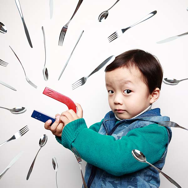 child and magnet