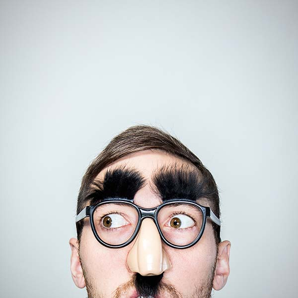 Funny man wearing Groucho glasses