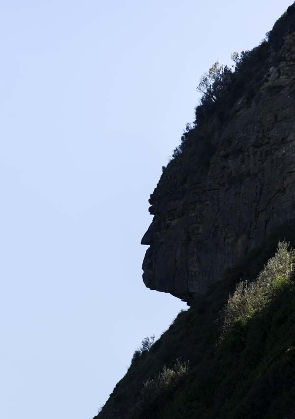 Naturally formed face on side of mountain
