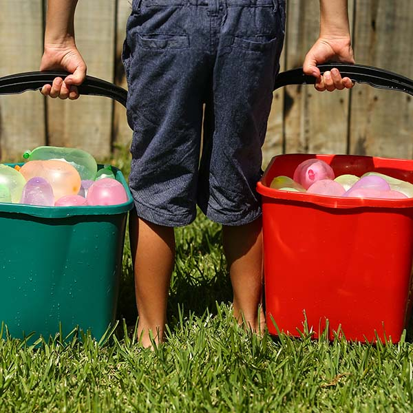 Young boy getting ready for a water balloon fight