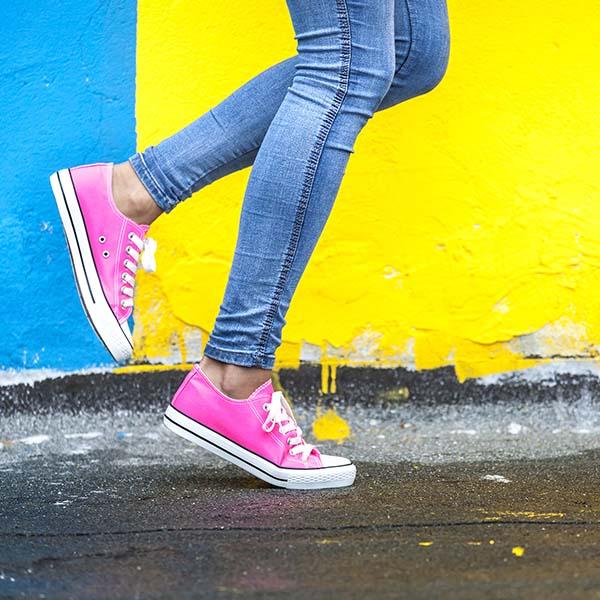 Mother running in pink sneakers
