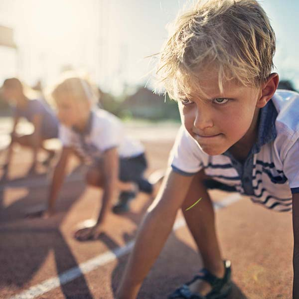 Boy at starting line determined to win
