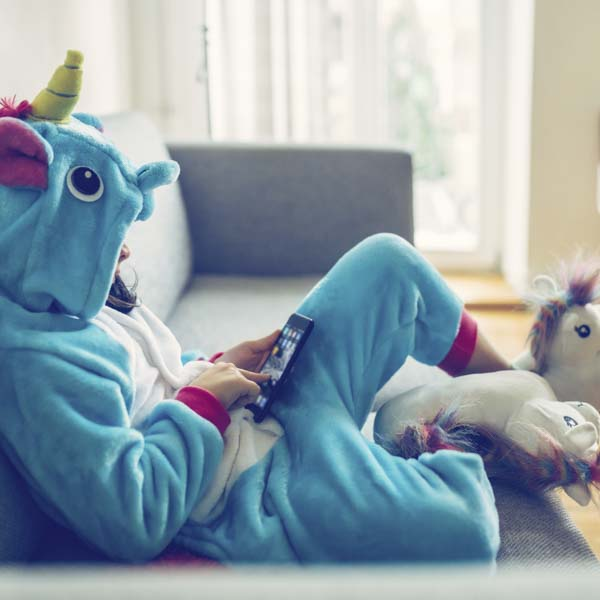 Unicorn indoors on couch