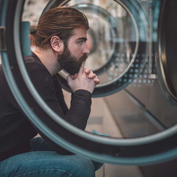 Man thinking at laundromat