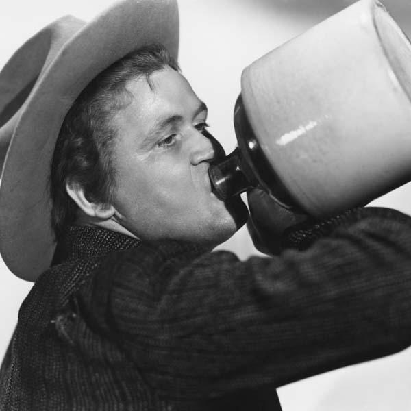 Vintage man drinking moonshine