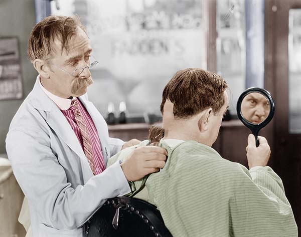 Vintage crazy barber and man in chair