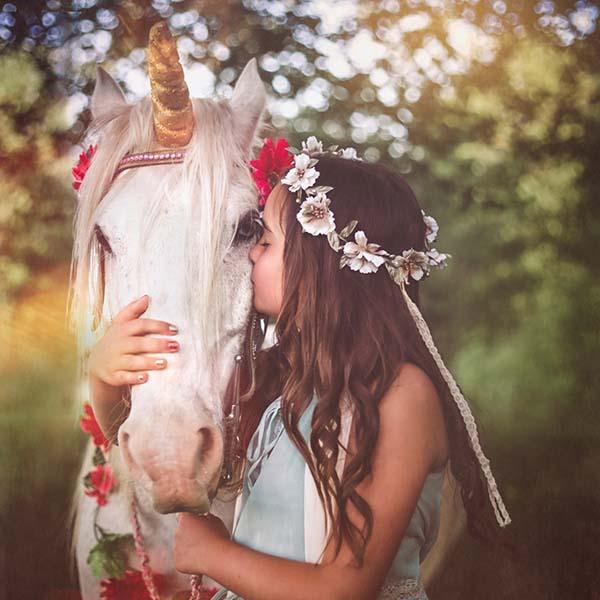 Girl kissing her unicorn