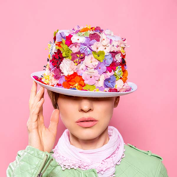 Woman with flower-covered hat