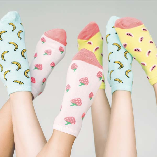 Friends wearing crazy fruit socks