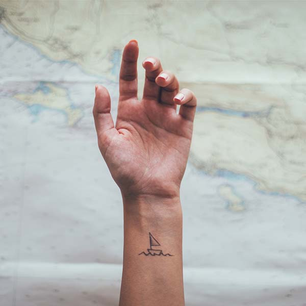 Woman's hand with boat tattoo