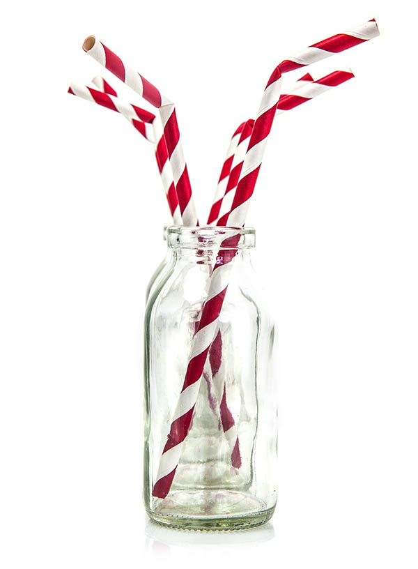 Red and white striped paper straws slightly bent
