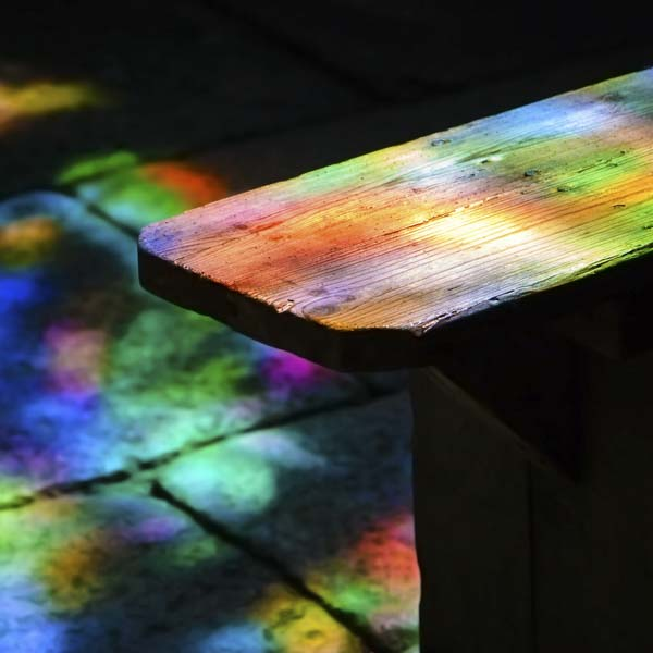 Bench surrounded by rainbow light