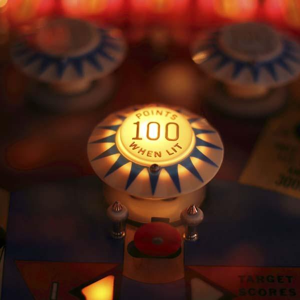 Vintage pinball machine lit