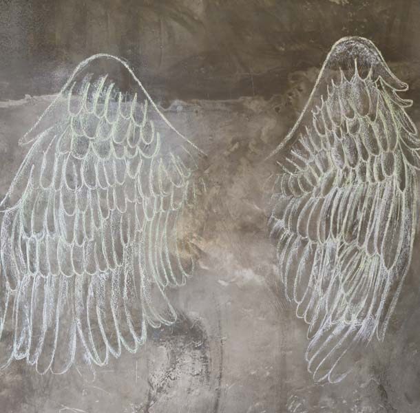 Angel wings in chalk on concrete wall