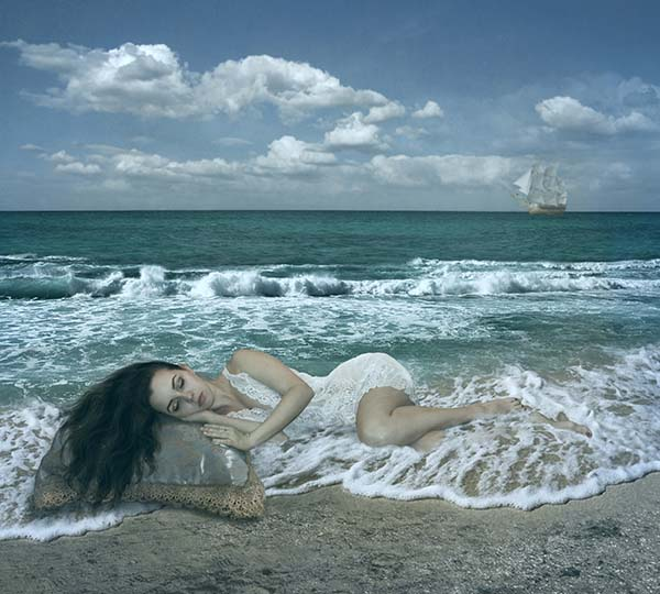 Woman sleeping in ocean scene