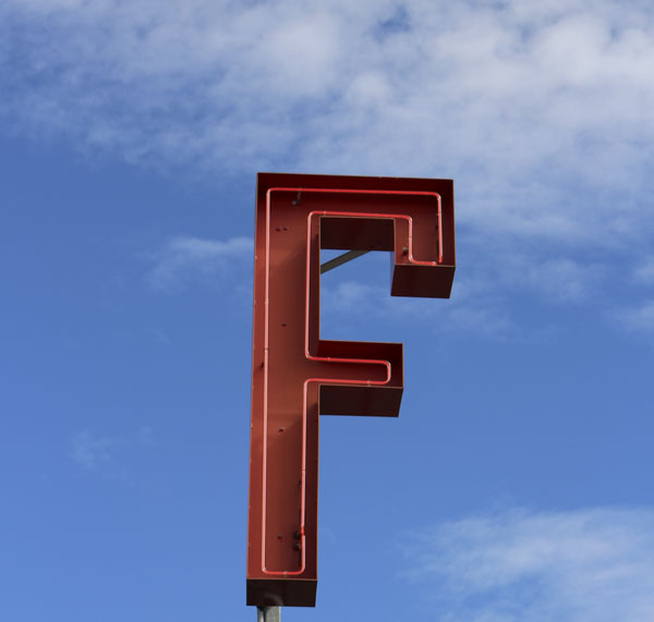 Neon road side with giant letter F in neon