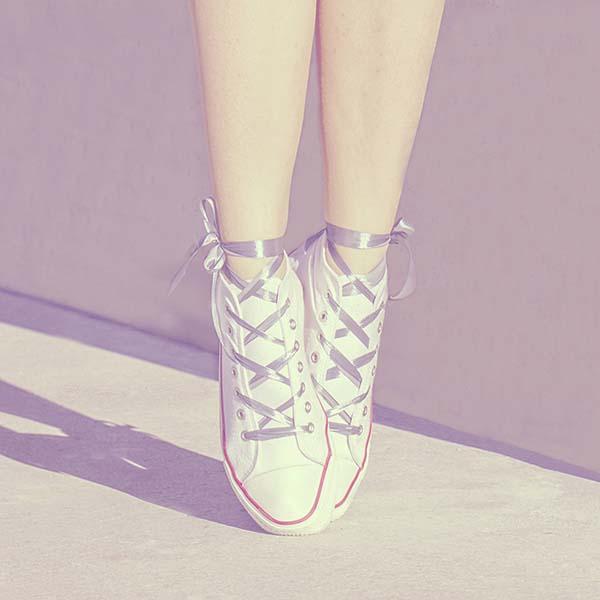 Ballerina in tennis shoes