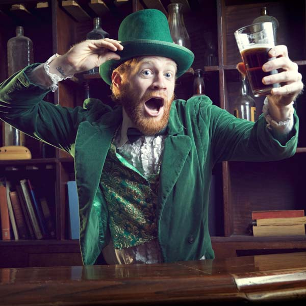 Happy man in bar raising his glass