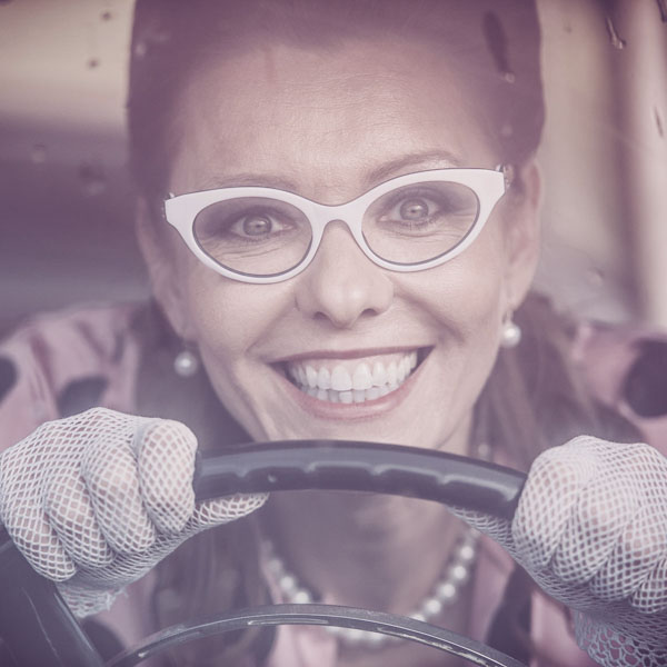Retro woman driving fast