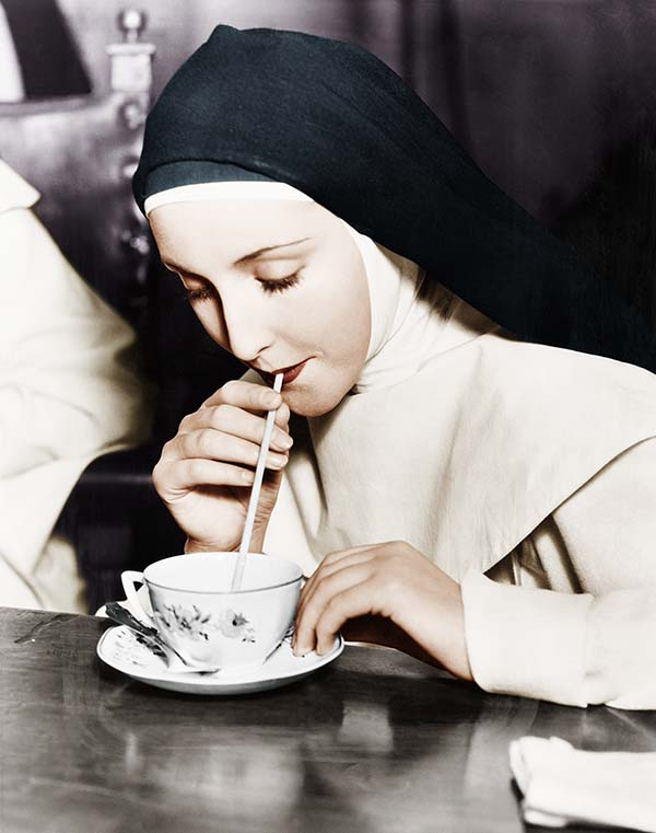Nun drinking through straw