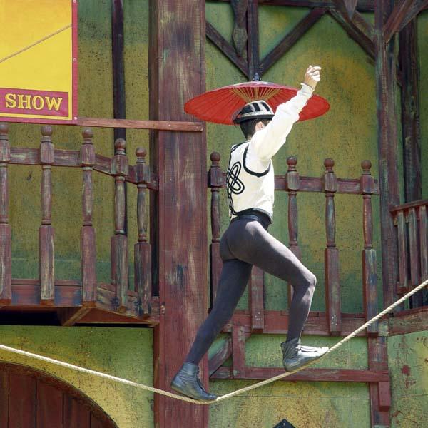 Acrobat walking tightrope