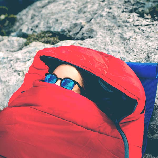 Woman tucked in sleeping bag