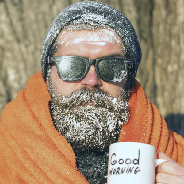 Man in blanket with frozen beard and beanie
