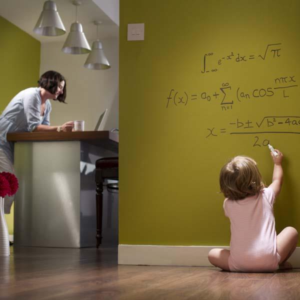 Baby Einstein writing math problem on wall