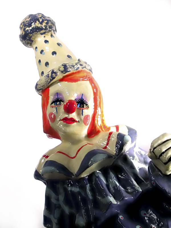 Funny girl clown figurine