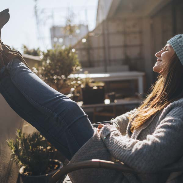 Woman relaxing in sun with feet up