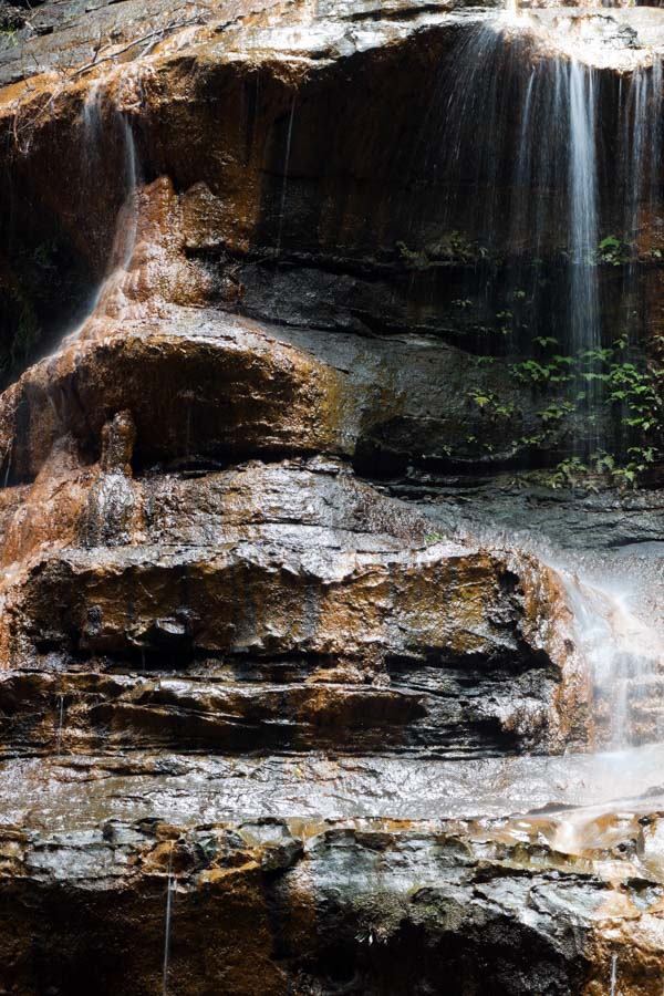 Rock face under waterfall