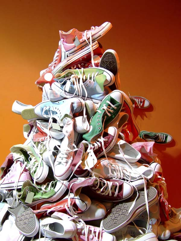 Pile of dozens of tennis shoes