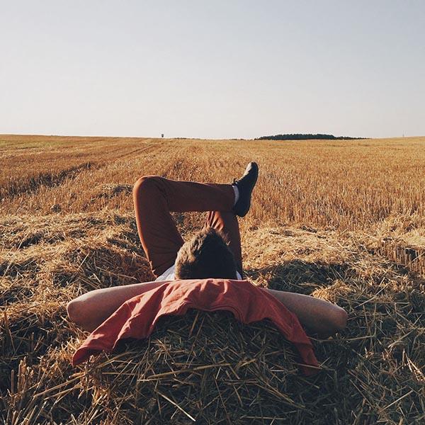Man reclining in hay field