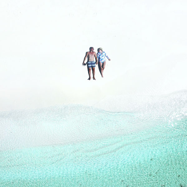Aerial view of couple on secluded beach