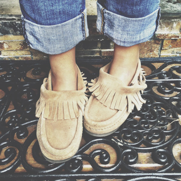 Close up of woman wearing moccasins